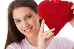 Pretty girl with red heart smiling Royalty Free Stock Image