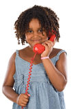 Pretty girl with red phone Stock Photos