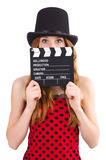 Pretty girl in red polka dot dress with movie board Stock Photography