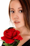 Pretty girl with red rose. Stock Images