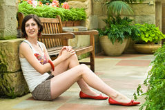 Pretty girl in red shoes Royalty Free Stock Images