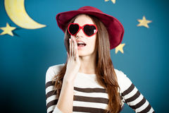 Pretty girl in red sunglasses with paper moon and Stock Photos