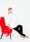 Pretty girl relaxing on chair Royalty Free Stock Photography