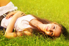 Pretty girl relaxing outdoor. Pretty smiling girl relaxing outdoor Stock Photography