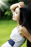 Pretty girl relaxing outdoors Stock Image