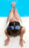 Pretty girl relaxing at the swimming pool in the summertime Stock Photos