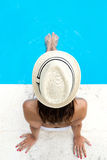 Pretty girl relaxing at the swimming pool in the summertime Royalty Free Stock Image