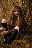 Pretty girl resting on straw bale Stock Photos