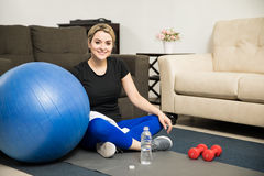 Pretty girl resting after working out at home Royalty Free Stock Photo