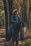Pretty girl riding her grey horse Stock Photo