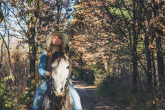 Pretty girl riding her grey horse Royalty Free Stock Photos