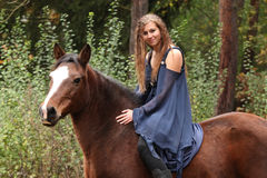 Pretty girl riding a horse without any equipment Royalty Free Stock Photography