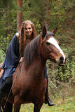 Pretty girl riding a horse without any equipment Stock Images