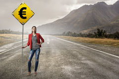 Pretty girl with roadsign . Mixed media Royalty Free Stock Photos
