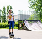 Pretty girl in rollerblades at the skate park Stock Photography
