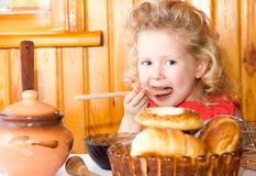 Pretty  girl with rolls and honey Stock Image