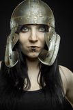 Pretty girl with  roman helmet. Pretty sexy girl with ancient roman helmet posing over dark background Royalty Free Stock Photos