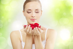Pretty girl with rose petals Royalty Free Stock Photo