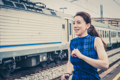 Pretty girl running along the tracks Stock Image