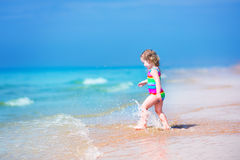 Pretty girl running on a beach Stock Photos