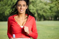 Pretty girl running in park royalty free stock photo