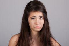 Pretty girl with a sad face Royalty Free Stock Images