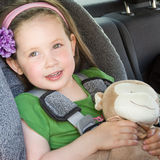 Pretty girl safe in her car seat Stock Image