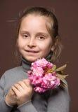 Pretty girl with sakura branch Royalty Free Stock Photo