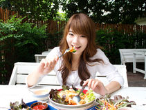 Pretty girl with salad. Thai pretty girl have a lunch with salad Stock Images