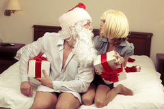 Pretty girl with Santa Claus Royalty Free Stock Image