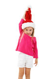 Pretty girl in a santa claus hat Royalty Free Stock Image