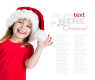 Pretty girl in santa claus hat Stock Image