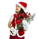 Pretty girl in Santa costume with Christmas bunch Stock Photography