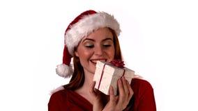 Pretty girl in santa costume holding gift box Royalty Free Stock Photo