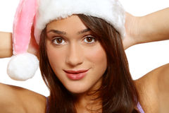 Pretty girl in Santa hat Stock Photography