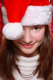 Pretty girl in Santa hat Stock Photo