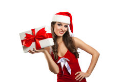 Pretty girl in santa hat with Christmas present Stock Photos