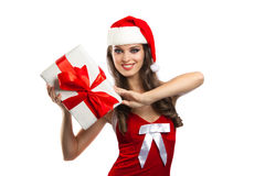 Pretty girl in santa hat with Christmas present Stock Photo