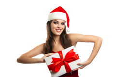 Pretty girl in santa hat with Christmas present Royalty Free Stock Photography