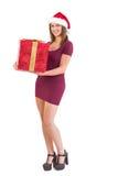 Pretty girl in santa hat holding gift box Stock Image