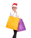 Pretty girl in santa hat with shopping bags Stock Image