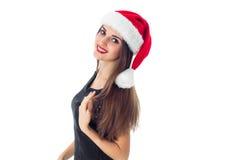 Pretty girl in santa hat Stock Photo