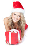 Pretty girl in santa helper hat with red gift Stock Images