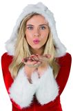 Pretty girl in santa outfit blowing Stock Photos