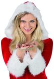 Pretty girl in santa outfit with hands out Royalty Free Stock Images