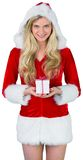 Pretty girl in santa outfit holding gift Royalty Free Stock Image