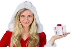 Pretty girl in santa outfit holding gift Royalty Free Stock Images