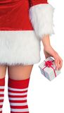 Pretty girl in santa outfit holding gift Stock Photos