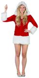 Pretty girl in santa outfit holding hand up Stock Image