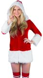 Pretty girl in santa outfit pointing Stock Image